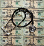 Stethoscope on a background of $20 bills Stock Photography