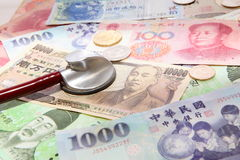 Stethoscope and Background of asian currency Stock Images