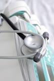Stethoscope on background medical syringe pump. Stock Photos