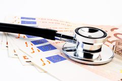 Stethoscope on banknote Royalty Free Stock Photos