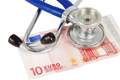 Stethoscope with banknote Stock Photography