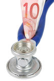 Stethoscope with banknote Royalty Free Stock Images