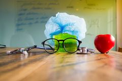 Stethoscope, beaker, glasses, medical cap and heart. Health Care. Researchers equipments stock photo