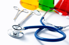 Stethoscope and beakers Royalty Free Stock Images