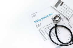 Stethoscope, billing statement for doctor`s work white background top view space for text. Stethoscope, billing statement for doctor`s work in medical center on Royalty Free Stock Images