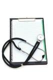 Stethoscope on the binder isolated Stock Photos