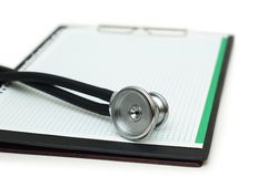 Stethoscope on the binder isolated. On white Stock Image