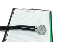 Stethoscope on the binder isolated on white Royalty Free Stock Photo