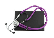 Stethoscope and black book Royalty Free Stock Photography