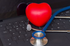 Stethoscope  on black keyboard Stock Image