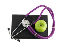 Stethoscope on the black medical book Stock Photography