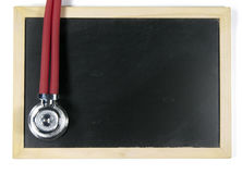 Stethoscope and blackboard Stock Image