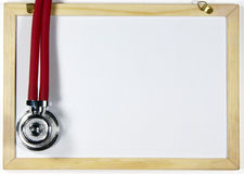 Stethoscope and blackboard Stock Images