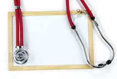 Stethoscope and blackboard Royalty Free Stock Image