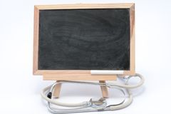 Stethoscope and blackboard Royalty Free Stock Photography