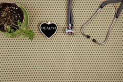 stethoscope, blackboard in the form of heart with word & x22;HEALTH& x22; stock photo