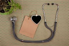 stethoscope, blank blackboard in the form of heart, shopping bag stock images