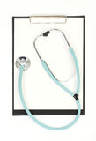 Stethoscope and blank clipboard on white background Royalty Free Stock Photo
