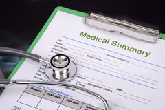 Stethoscope and blank medical record. Stock Photos