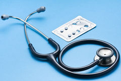 Stethoscope and Blister Pack Stock Photo