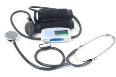 Stethoscope & blood-pressure device. Isolated on white Royalty Free Stock Photo