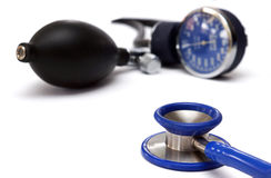 Stethoscope and blood pressure equipment. A stethoscope and blood pressure gauge on a white background Stock Image