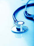 Stethoscope on blue background Stock Images