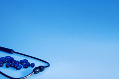 Stethoscope on blue background Royalty Free Stock Photos
