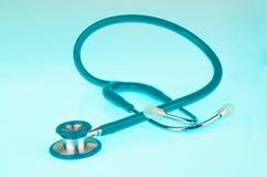 Stethoscope on blue background Stock Image