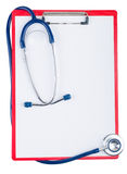 Stethoscope and blue clipboard Royalty Free Stock Photos