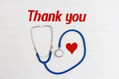 Stethoscope blue colored, red heart and text thank you.Healthcare and medical concept. World health day