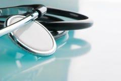 Stethoscope on blue, reflective background Royalty Free Stock Photo