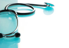 Stethoscope on blue, reflective background Royalty Free Stock Images