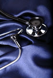 Stethoscope on blue satin Stock Image