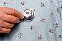 Stethoscope on body of patient Royalty Free Stock Photography