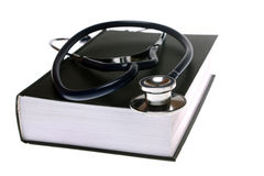 Stethoscope with book Stock Photos