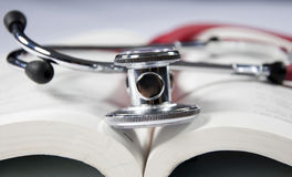 Stethoscope and book Stock Images