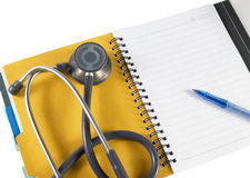 Stethoscope And Book. Stethoscope , book and pen with white background Royalty Free Stock Photography