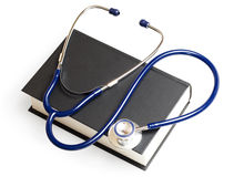 Stethoscope and book Royalty Free Stock Photos