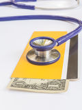 Stethoscope and book bank Royalty Free Stock Image