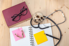 Stethoscope , book note and skull Royalty Free Stock Photo