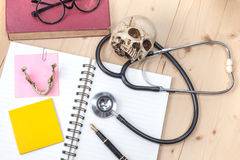 Stethoscope , book note and skull Stock Images