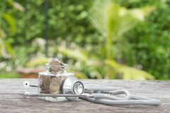 Stethoscope on bottle and coin on wooden background. Concept of Royalty Free Stock Photography