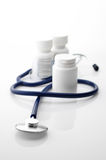 Stethoscope and bottles Royalty Free Stock Photography