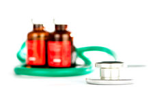 Stethoscope with bottles of injection medicine Stock Images