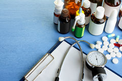 Stethoscope and bottles of medicines Royalty Free Stock Photo