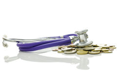 Economic crisis recovery. Stethoscope on bunch of coins representing concept of economic crisis recovery Stock Photo