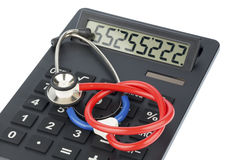 Stethoscope and calculator Stock Images