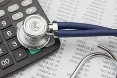 Stethoscope and calculator Stock Photography