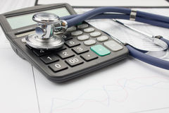 Stethoscope and calculator Royalty Free Stock Photo